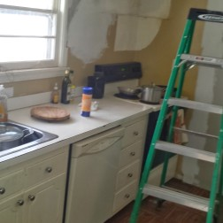 This old kitchen is now the new dining room. The space where the oven used to be located is now a small laundry room.